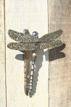 Dragon fly door knocker  35 euros plus postage of about 10 euros made to order by artist blacksmith living in France. email phill@apex-arts.com  website www.apex-arts.com/Insect%20Sculpture%20uk.htm#