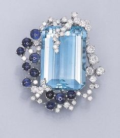AN AQUAMARINE, SAPPHIRE AND DIAMOND BROOCH