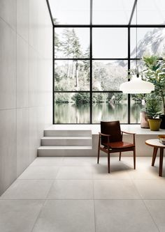 Concrete – a contemporary, bold material softened by a Nuvolato effect of high aesthetic and chromatic value – finds its perfect expression in the new R-Evolution porcelain stoneware collection. Industrial Tile, Industrial Architecture, Urban Chic Fashion, Wall And Floor Tiles, Cladding, Surface Design, Evolution, Living Spaces, Living Area