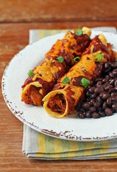 These sweet and spicy Buffalo Chicken Enchiladas are the recipe mashup dreams are made of, and two are only 329 calories or 8 Weight Watchers SmartPoints!