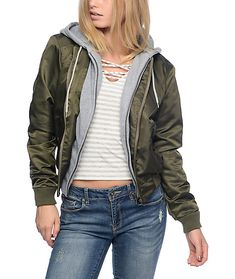 Take flight in this Mika olive bomber fleece hooded jacket from Trillium. The olive shell pairs perfectly with the light grey, double lined hood and first layer to create a warm and stylish bomber jacket.