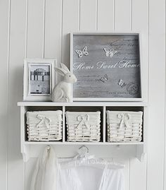A White Wall Shelf With 2 Baskets And Hanging Pegs 163 35