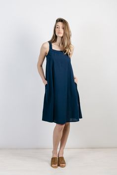 A-line sleeveless sundress with on-seam pockets and buttons down the back. Hem hits slightly below the knee. An easy breezy summertime dress made in fresh seasonal fabrics. Create new looks by belting