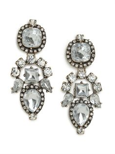If you like your glamour with a feisty kick, then you'll fall for these gorgeous drop earrings. Subtly inspired by Aztec graphics and crafted from a treasure chest's worth of ice-white gems, they're simply spectacular.