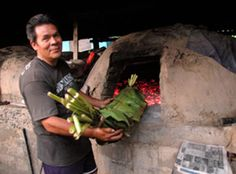 This home baker in northern Veracruz is an expert in his village for preserving the ancient culinary tradition of the zacahuíl, or gigantic banana leaf-wrapped tamal. This tamale will serve over 100 people on Day of the Dead. It's a pistol to construct and wrap so it doesn't fall apart; then baked in a homemade adobe outdoor oven. It's then sealed with mud until morning.
