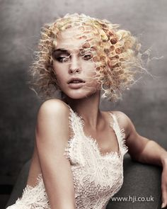Avant garde Angelo Seminara textured bob How to get the look A blonde hairpiece was created to look like a web, with sections loosely pulled apart to create a slightly frayed feel. Hair was then slicked back against the head with the hairpiece secured on top.