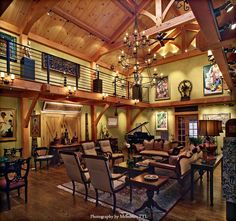 Private timber frame art gallery by Davis Timber Frame. Photography by Memories TTL.