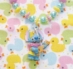 Kawaii Hawaii bead and button stitch bracelet  by NiNEFRUiTSPiE, £3.50
