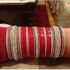 Red Zarkan Bridal Chura.  Website For Purchase : www.weddingchura.com Whatsapp For purchase : +919416307694