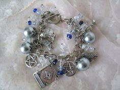 Witch's Spellbook Pentacle Charm Bracelet, wiccan jewelry goddess pagan witchcraft gypsy occult metaphysical new age wicca pentagram. $22.99, via Etsy.
