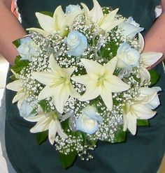White Asiatic lilies and light blue tipped white roses