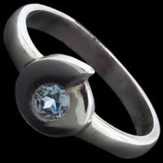 Silver ring, CZ, spiral Silver ring, Ag 925/1000 - sterling silver. With stones (CZ - cubic zirconia). An attractively designed ring with a round zircon set in a silver spiral.