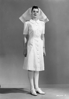 RCAF Nursing Sister, white uniform, 18 Dec (Library and Archives Canada Photo, MIKAN No. Skaarup, author of Shelldrake Vintage Photographs, Vintage Photos, History Of Nursing, Medical History, Blouse Nylon, Nurse Photos, Professional Nurse, Vintage Nurse, Nursing Career