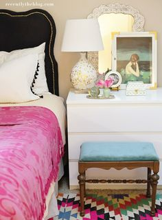 This would be so easy to imitate. White bed spead, solid bright blankets. all white drawers, mirrors/picture frame. solid bright stool in a contrasting color. and a patterned rug.