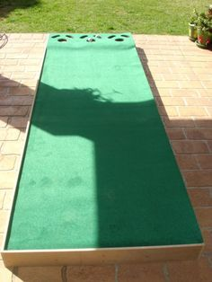 Build your own indoor putting green. My guy would looooove this ...