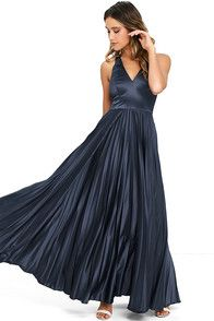 Whatever the occasion, make the most of it in the Epic Night Navy Blue Satin Maxi Dress! Elegant satin, in a lovely navy hue, shapes a sleeveless, princess-seamed bodice with V-neckline. A tying back supports wide draping straps atop a fitted waist, and accordion pleated maxi skirt. Hidden back zipper and clasp.