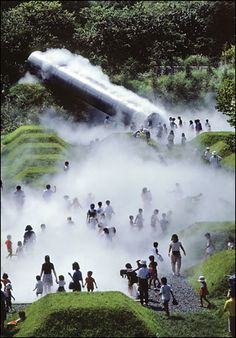 """Children in the Mist: In Tokyo's Showa Kinen Park, a ''fog forest,"""" above, combines truncated pyramids with a 32-foot steel tube that emits artificial fog every 15 minutes. Atsushi Kitagawara Architects collaborated with the artist Fujiko Nakaya to create this mist-shrouded world, where the fog shifts and clears just as it does in real life."""