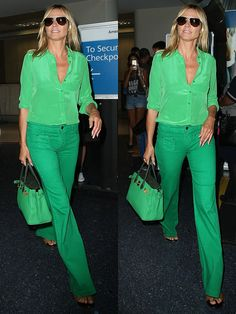 Heidi Klum wearing an all-green outfit at the Los Angeles International Airport (LAX) on July 25, 2016