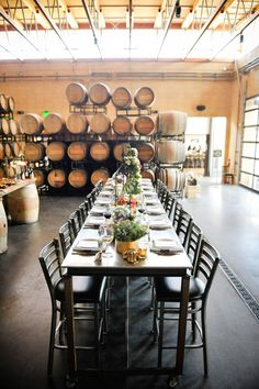 An enormous steel-and-glass door welcomes guests to this rustic-yet-modern venue. Inside the barrel room, 160 full barrels of wine make for a unique evening