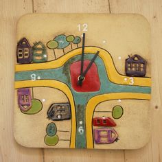 Keramické hodiny město 2 Originální keramické hodiny o velikosti cca 27x27 cm, dekorované glazurami a oxidy.