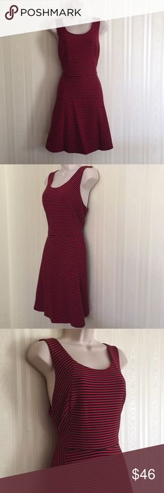 EXPRESS striped dress NEVER WORN Red with navy blue stripes.  This is a beautiful eye-catching dress, and is very flattering when on. This dress is in excellent condition and has never been worn - would be great for the office or a night out on the town. Don't miss this great deal! Express Dresses