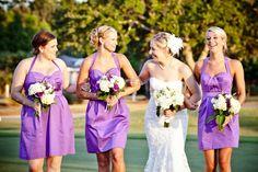bride and bridesmaids in short purple dresses