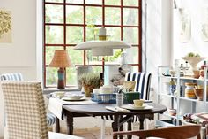 farmhouse country vibes   this french inspired kitchen is just goals   farmhouse style kitchen table   huge windows   seen here IKEA Henriksdal chairs with Bemz covers