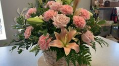 Beautiful pink lilies, carnations, blush roses and white tea roses with lush greenery in a white washed basket Basket Flower Arrangements, Funeral Floral Arrangements, Artificial Floral Arrangements, Beautiful Flower Arrangements, Silk Flower Arrangements, Beautiful Flowers, Faux Flowers, Silk Flowers, Altar Flowers