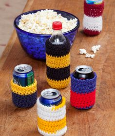 Crochet Can Cozies Crochet Pattern | Red Heart Show your spirit with can cozies in favorite team colors! These crochet cozies are sized to fit smaller energy drink cans or regular size cans and bottles. Great treat for the whole cheering section!