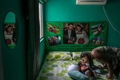 IPOJUCA, BRAZIL 1/31/2016 Germana Soares, 24, with her 2-month-old son, Guilherme, who was born with microcephaly. Brazil saw a surge in birth defects related to the mosquito-borne Zika virus. Mauricio Lima for The New York Times