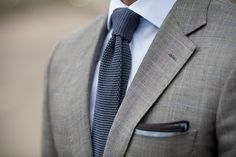 Grey suit, navy shirt and tie.