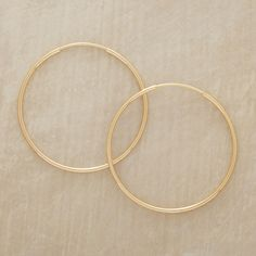 """ENDLESS HOOPS OF GOLD--Dressed up or down, these endless hoops of gold earrings perk up your wardrobe with infinite potential. 14kt gold. Handmade by Suzanne Kalan in USA. 1"""" dia."""