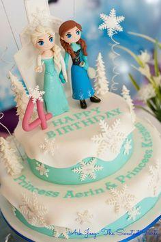 A beautiful Princess Elsa & Anna two tier fondat cake #disneyfrozen