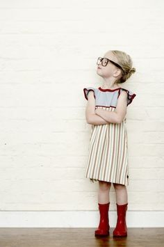 Use a blank wall for photobooth style shoot with kids. Change clothes and poses and make it fun and playful for them.