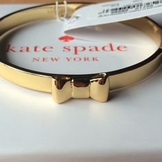 """Kate Spade """"Take A Bow"""" Gold Bangle Super cute bangle adorned with a golden bow by Kate Spade! New with tags including the dust bag and box, would make a perfect gift. The bangle has no clasp, it slides on and off. It is about 2.5 inches in diameter. Feel free to contact me if you'd like more information on this product! kate spade Jewelry Bracelets"""