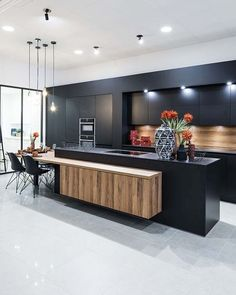"Black adds a hit of posh style to any cooking Space . For a less Stark ,but equally chic option, consider""almost Black"" colors that are… Kitchen Room Design, Luxury Kitchen Design, Contemporary Kitchen Design, Home Decor Kitchen, Kitchen Living, Interior Design Kitchen, Modern Kitchen Interiors, Modern Kitchen Island, Küchen Design"