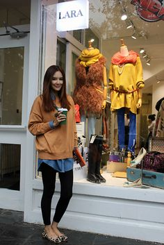 chambray shirt, camel sweater, leopard flats