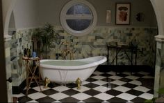 """Bathroom: fantastic round window, clawed tub, black/white floor & curved archway. From Victorian House on """"Witches of East End""""   hookedonhouses.net"""