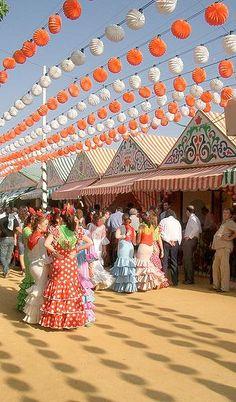 Seville, Spain during their April Fair. Flamenco dresses & horses, dancing & drinking...