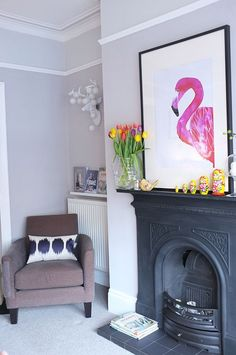 Two tones of grey have been used in this living room - Polished Pebble (Dulux) and Eglise grey (Crown), and the look is finished with a fantastic pink flamingo piece of wall art.