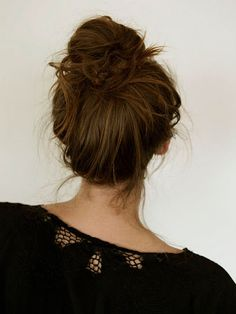 """Messy bun. I actually like my hair to be slightly neater when all is said and done, but the """"troll doll"""" technique has been invaluable to my hair routine."""