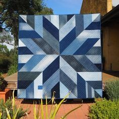 Blue Giant quilt made from upcycled jean Created by: Stitch and Yarn