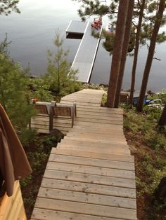 Steps going down to the lake but add railings. Cottage Stairs, Lake Cottage, Hillside Deck, Staircase Outdoor, Landscape Stairs, Wooden Walkways, How To Build Steps, Building Stairs, Outdoor Steps