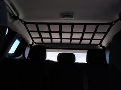 Jeep Renegade adjustable ceiling net for jackets, first aid kits and lighter cargo. Great rear view visibility is maintained. Mounts to OE locations with new PVC coated steel hardware. All Raingler pr