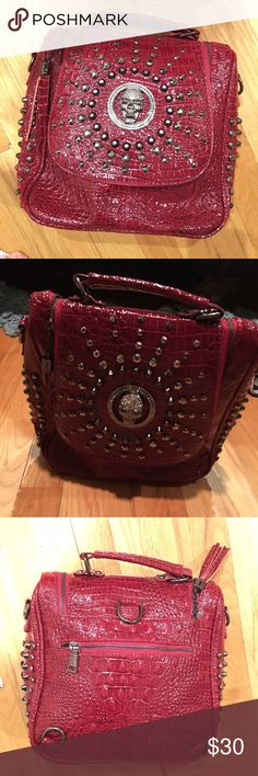 Red studded leather crocodile bag with skull jewel Gorgeous and sturdy red studded leather crocodile bag with skull jewel. Silver and gunmetal gems and studs. Never been worn! Bags Backpacks