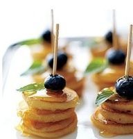 Mini pancakes with blueberries and strawberries on top
