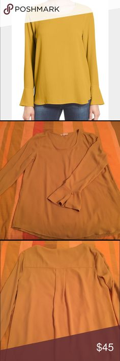 NWOT Pleione Bell Cuff High Low Blouse Gorgeous custard yellow color! Has planned on wearing it to an event but didn't and haven't touched it since. So it's brand new! Pleione Tops Blouses
