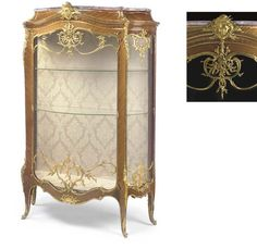 A FINE LOUIS XV STYLE ORMOLU-MOUNTED TULIPWOOD BOMBE VITRINE <BR> BY FRANÇOIS LINKE, INDEX NUMBER 905, THE MOUNTS DESIGNED BY LÉON MESSAGÉ, PARIS, EARLY 20TH CENTURY<BR> The serpentine <I>brèche violette</I> marble top above a spreading pediment headed by a seaweed-draped mermaid mask, above a central <I>bombé</I> glazed door set within an ormolu frame cast with foliage and trelliswork and with similarly-mounted glazed sides, the silk-lined interior fitted with three adjustable glass ...