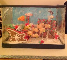 Gingerbread aquarium with poured sugar as glass