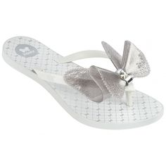 Fresh Butterfly Silver Glitter  Style with a romantic concept inspired by fairy tales! This flip flop is stunning - with delicate butterfly detailing on the insole, and a Zaxy metallic gold butterfly clasp to complete the elegant look!